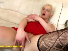 nasty housewife playing with her glass sex toy
